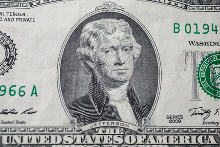 banknote: Portrait of the third US President Thomas Jefferson on two-dollar banknote bill, background of the money, two dollar bills front side obverse. background of dollars, close up, America
