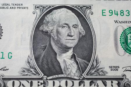 1 달러 지폐에 미국, 미국 건국의 아버지 조지 워싱턴 초대 대통령의 초상화, 돈의 배경, 1 달러 지폐 앞면의 앞면. 달러의 배경은 미국을 닫습니다