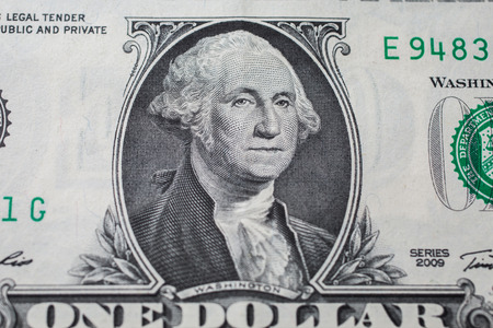 portrait of the first president of the United States, the US founding father George Washington on the one dollar bill, background of the money, one dollar bills front side obverse. background of dollars, close up, America Reklamní fotografie