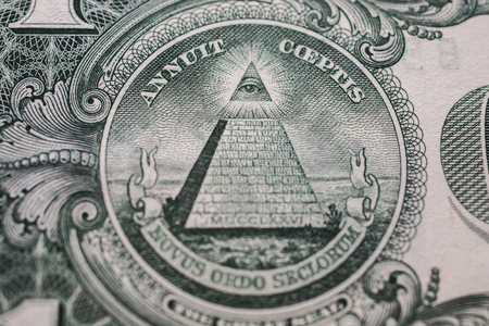 all-seeing eye, truncated pyramid closeup, money background ,one dollar bill down back reverse side, background of dollars, close up, America