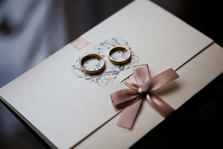 wedding bands: wedding rings on a white background,wedding bands, invitation card