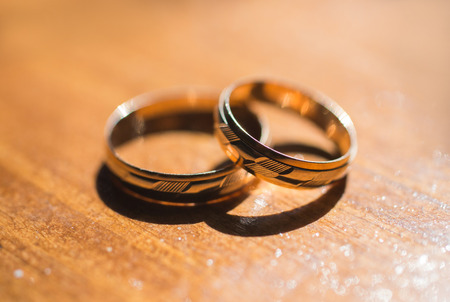 wedding bands: infinity sign of the rings, wedding rings on a yellow background,wedding bands Stock Photo