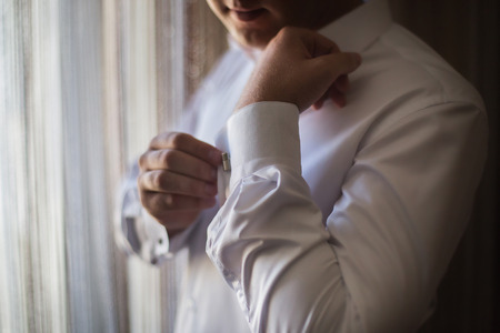 wrist cuffs: man wear a shirt and cufflinks, correct clothes, dressing, mans style, fees groom, wedding preparations, sense of style Stock Photo