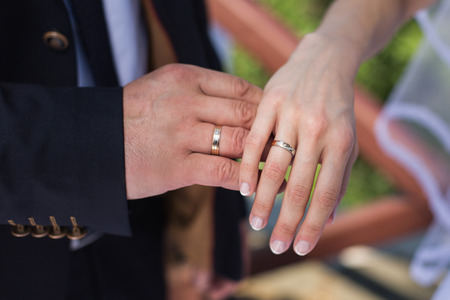 rose ring: wedding rings on their hands, a ring on the finger the bride and groom with rings Stock Photo