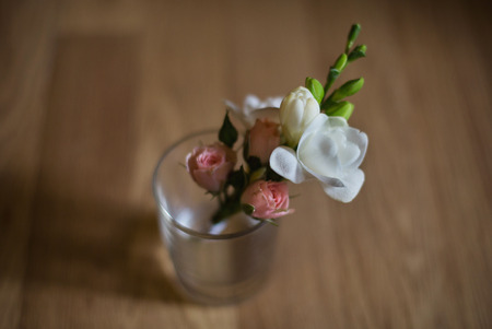 boutonniere: wedding boutonniere of pink roses and white flower