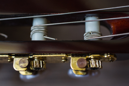 tune: guitar neck, close-up, tune the guitar Stock Photo