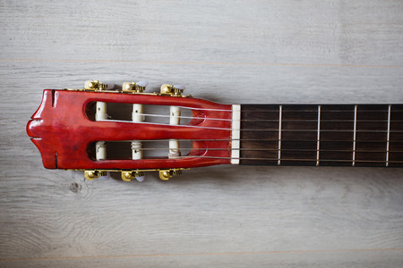threshold: guitar neck on a wooden background, musical instrument, fretboard Stock Photo