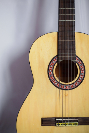 acoustical: Guitar on wooden background, fretboard Stock Photo