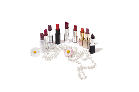 pomatum: Womens lipsticks isolated on white background, womens jewelry, flowers on a white background