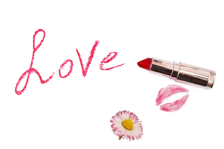 pomatum: Lipstick isolated on white background. Female lip pencil. Kiss of lips on the paper. The word love written in lipstick. White flower.