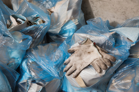 putty knives: Working gloves. Collect garbage in the garbage bag, put things in order. Do makeovers. Stock Photo