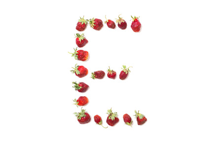 e white: Red strawberries isolated on white background. Funny letters. English alphabet. ABC. Letter E