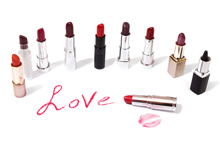 lip pencil: Lipstick isolated on white background. Female lip pencil. Kiss of lips on the paper. The word love written in lipstick.