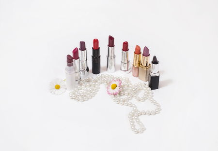 Womens lipsticks isolated on white background, womens jewelry, flowers on a white background