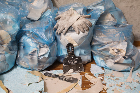 throwing knife: Working gloves. Collect garbage in the garbage bag, put things in order. Do makeovers. Stock Photo