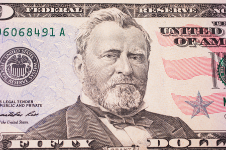 50 dollar bill: background of the money, fifty dollar bills front side. background of dollars, close up, Portrait of U.S. statesman, inventor, and diplomat Ulysses S. Grant as he looks on fifty dollar bill obverse , face bill of fifty dollars Stock Photo