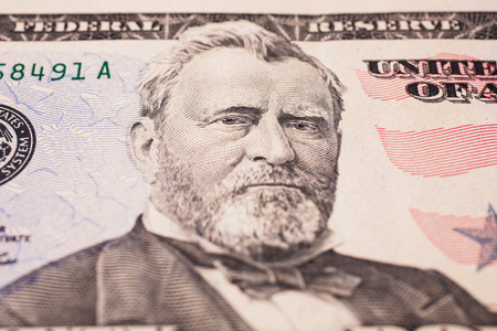 statesman: background of the money, fifty dollar bills front side. background of dollars, close up, Portrait of U.S. statesman, inventor, and diplomat Ulysses S. Grant as he looks on fifty dollar bill obverse , face bill of fifty dollars Stock Photo