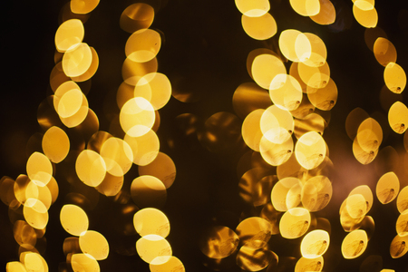 Fabulous winter bokeh of golden garlands. Abstract background. Christmas tree