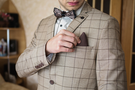 A man correct handkerchief in his jacket pocket. Mens style. Professions. To prepare for work, to the meeting. Stock Photo