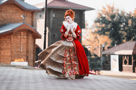 jabot: Red Queen in the castle. Red-haired woman in a chic vintage dress. Fashion Photo