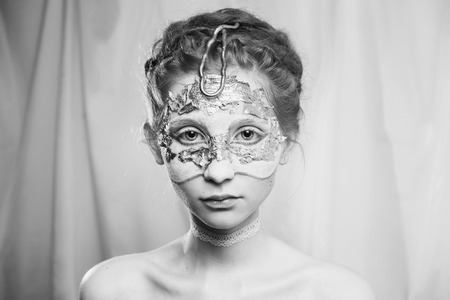 colorless: Black and white art photography monochrome, hairstyle in the Greek style. Vogue style portrait of a girl with a white bodyart on her face. Body painting project. Woman painted white colors. Makeup Stock Photo
