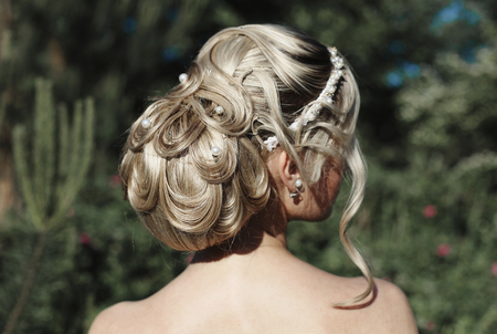 Beautiful high hairstyle. Blonde with a tuft of hair. Diadem Stock Photo