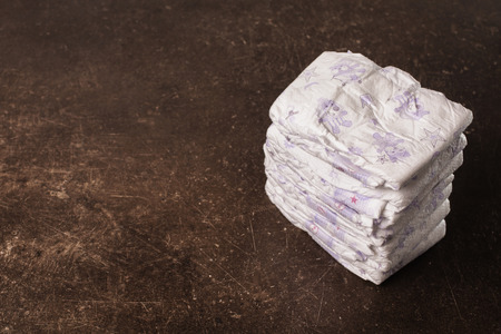 incontinence: Baby diapers on a dark marble background. Hygiene. Caring for children Stock Photo