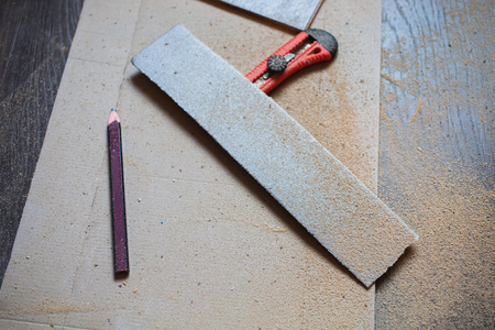 parquet floor layer: Do makeovers. Sawn board. Make a drawing. Sawdust from a tree. Building tools. Stock Photo