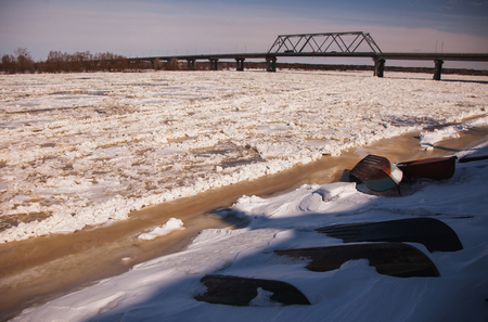 floating bridge: Winter landscape. Ice on the river. Clear sunny sky. The bridge over the river Stock Photo