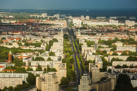 Travel to Germany. View of the houses and streets of Berlin with a birds-eye view. Overcast sky. Light from the sun on the houses. Residential houses. Megapolis. European city