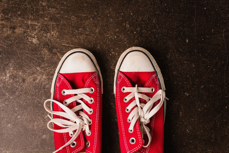 Red sneakers on a dark marble background. Footwear for outdoor activities Reklamní fotografie