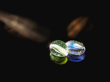 glass beads on black glass, colorful reflection, black background, fabulous view, beautiful abstraction