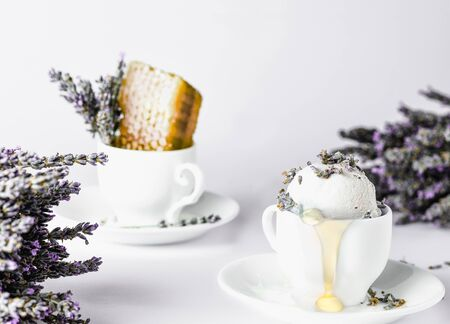 lavender honey ice cream in a coffee cup, lavender flowers, honey honeycombs, white background, high key 版權商用圖片