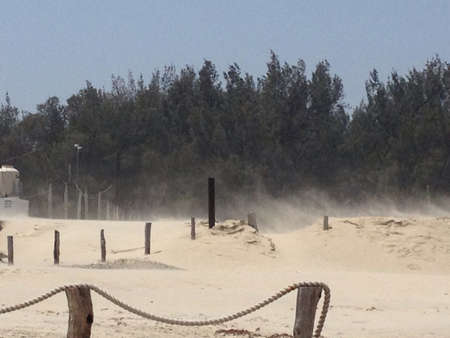 Sand storm caused by wind front rushing inland fro the sea
