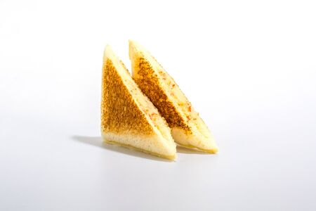 Triangle sandwich with crab stick and mayonnaise on white background.