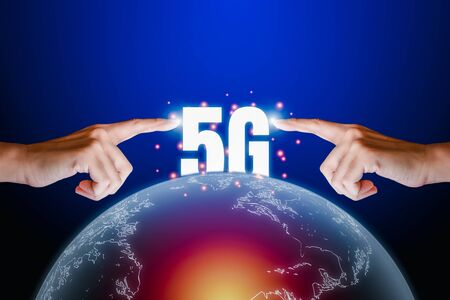 Hight speed internet concept. Human finger point on transparency of the earth and text 5G on blue technology background with copy space. Internet connection and communication around the world.