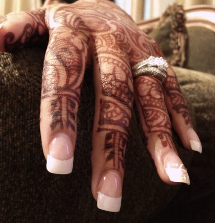 A brides hand decorated with Henna tattoo.
