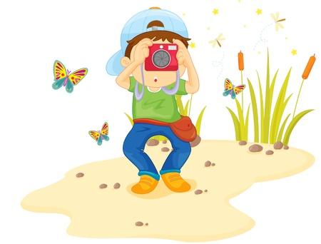 観察: 写真を撮る砂の上の少年