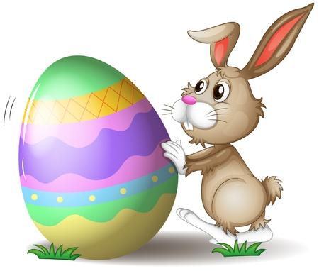 흰색 배경에 부활절 달걀을 추진하는 토끼의 그림