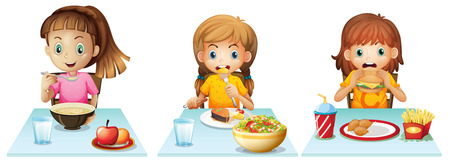 healthy kid: Girls eating at the dining table