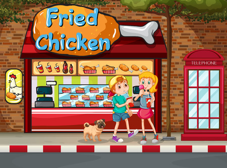 fried: Children eating junkfood in front of fried chicken shop