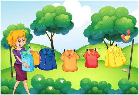 ropa colgada: Chica colgar la ropa en la línea exterior de la casa