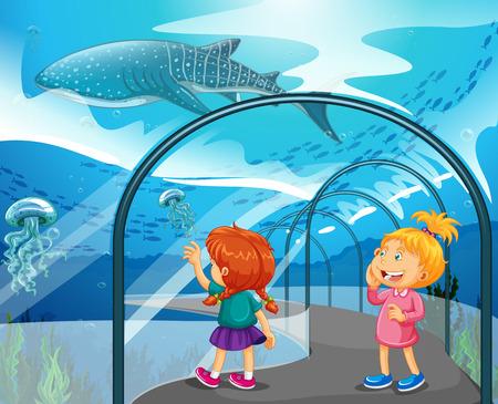 Dos niñas que visitan la ilustración acuario
