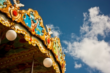 Carousel in the park with blue sky
