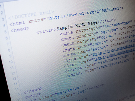 HTML source code of web page with document title, metadata description and links monitor screenshot diagonal view