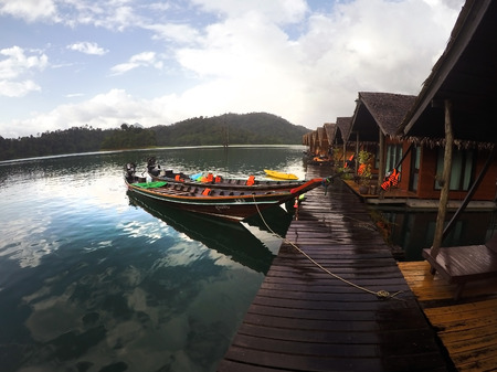 house float on water: long tail boat and raft house in lake, Suratthani Thailand Stock Photo