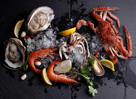 Fresh Seafood ,Crab Shrimp Oyster on stone background