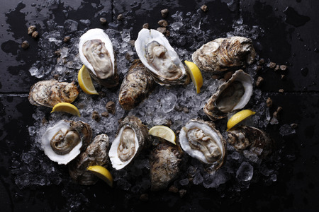 Fresh oysters platter with sauce and lemon Stock fotó