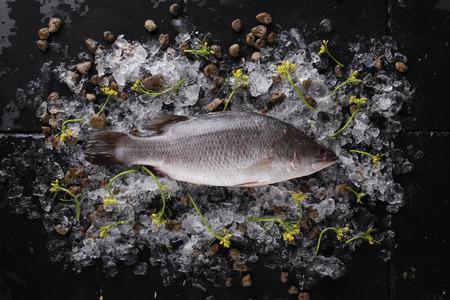 Fresh fish on ice on a black stone Stock fotó