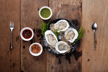 Fresh Oyster with side dish,Ready to eat. On The Table Stock fotó